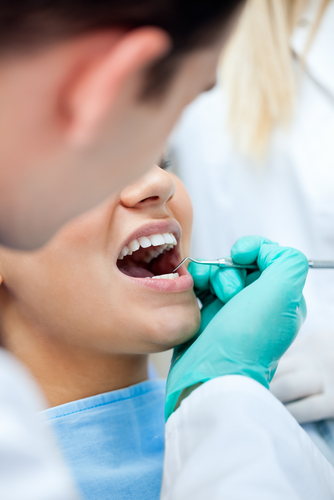 dental with female patient shutterstock_118787944