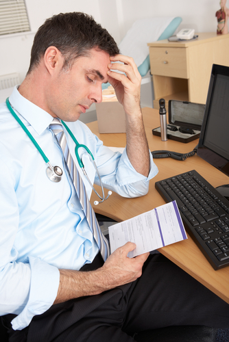 tired doctor shutterstock_98521181